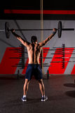 Barbell weight lifting man rear view workout gym Royalty Free Stock Photos