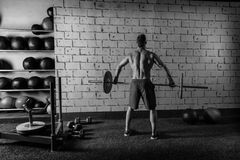 Barbell weight lifting man rear view workout gym. Weightlifting Stock Image