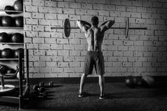 Barbell weight lifting man rear view workout gym. Weightlifting Stock Images
