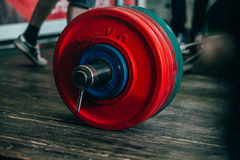 Barbell on a wooden floor. Closeup barbell on a wooden floor during a powerlifting competition royalty free stock image