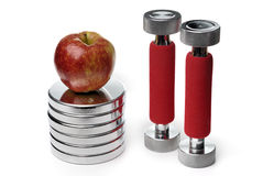 Barbells and apple isolated on white. Background Stock Photos