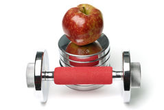 Barbells and apple isolated on white. Background Royalty Free Stock Photography