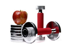 Barbells and apple isolated on white. Background Royalty Free Stock Image