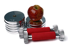 Barbells and apple isolated on white Stock Photo