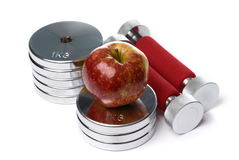 Barbells and apple isolated on white Royalty Free Stock Photography