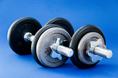 Barbells on Blue royalty free stock image