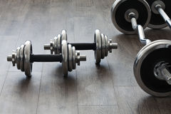 Barbells and dumbbells. Perpendicular to each other Royalty Free Stock Image