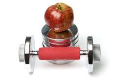 Barbells e mela isolati su bianco Fotografia Stock Libera da Diritti