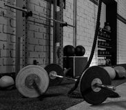 Barbells in a gym bar bells and rope Stock Image