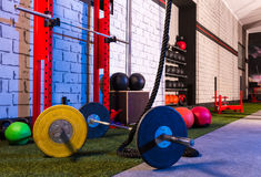 Barbells in a gym bar bells and rope Royalty Free Stock Image