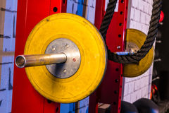 Barbells in a gym bar bells and rope Royalty Free Stock Photography