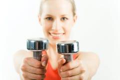 Barbells in hands Stock Image