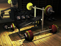 Barbells. Inside a weight-lift center, several barbells on the floor Stock Photos