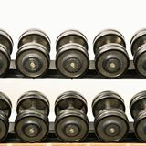 Barbells on rack Royalty Free Stock Image
