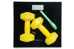 Barbells with roll measuring tape on the scales Stock Photography