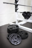 Barbells weight plate and gloves Stock Photo