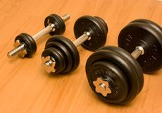 Barbells on Wooden Floor Stock Image