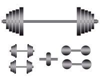 Barbells y pesas de gimnasia para el ejercicio Fotos de archivo libres de regalías