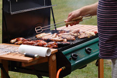 Barbeque. Cooking on the barbeque - sausages, spare ribs, chicken and tuna steaks royalty free stock photography