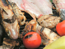 Barbeque. With fish and vegetables Stock Photos
