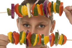 Barbeque. Girl with vegetables prepared to the baking on the grill Royalty Free Stock Photography
