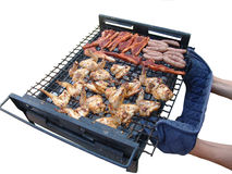 Barbeque. Person handling barbeque stock images