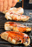 Barbeque chicken cooking on the grill Stock Images