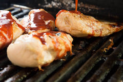 Barbeque chicken cooking on the grill Stock Image