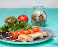 Barbeque chicken with tomatoes in a plate with salad Stock Image