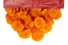 Barbeque Chips Spill Onto White Background Royalty Free Stock Images