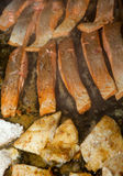 Barbeque - cooking of fish Royalty Free Stock Photos