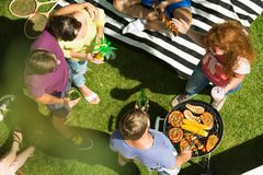 Barbeque dinner on fresh air. Friends enjoying a barbeque dinner party while being on a fresh air in a park royalty free stock photography