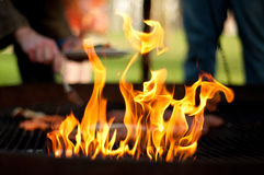 Barbeque fire. Flames on a barbeque grill royalty free stock photography