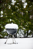 Barbeque grill covered with snow Royalty Free Stock Images