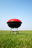 Barbeque grill on meadow Stock Photo