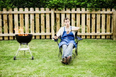 Barbeque: Man Checks Time on Watch Royalty Free Stock Photography