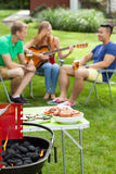Barbeque party. Happy student spending nice time on barbeque party Royalty Free Stock Images