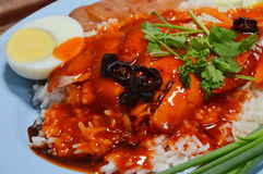Barbeque pork on rice and dressing with red sweet sauce Stock Photography