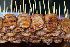 Barbeque pork in wooden stick Stock Photos