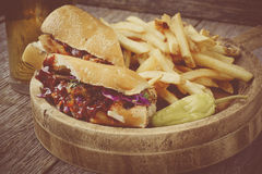 Barbeque Pulled Pork Sandwich with BBQ Sauce with Instagram Style Filter. Stock Photo