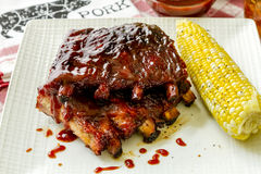 Barbeque racks of ribs with sauce Stock Images