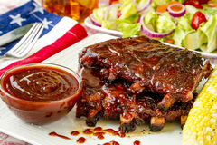Barbeque racks of ribs with sauce Stock Photos