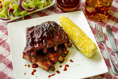 Barbeque racks of ribs with sauce Royalty Free Stock Photos