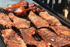 Barbeque Ribs. Juicy barbeque ribs cooking on open grill royalty free stock image
