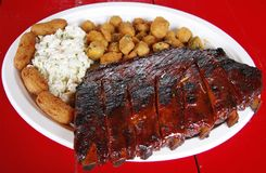Barbeque Ribs. A plate of barbeque ribs and side dishes Stock Photography