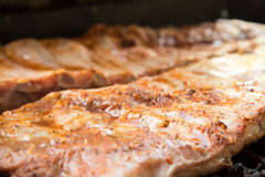 Barbeque ribs cooking on the grill Royalty Free Stock Images