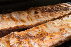 Barbeque ribs cooking on the grill Stock Photography