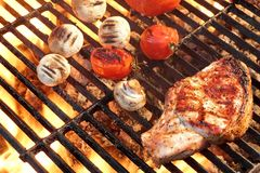 Barbeque Roasted Rib Steak, Tomatoes And Mushrooms On Hot Grill Royalty Free Stock Images