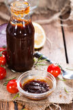 Barbeque Sauce. With Tomatoes, Smoked Salt and fresh Herbs (on rustic wooden background stock photos