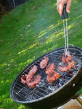 Barbeque with sausages. Cooking sausages on the barbeque Royalty Free Stock Photo